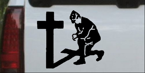 Military Man Kneeling at Cross